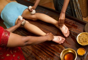 indian doctors doing traditional panchakarma kur oil massage